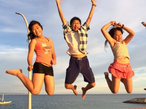 Jumping while watching sunset at Bali Beach.