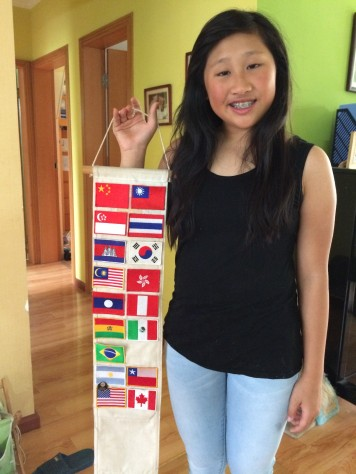 Joani holding flags of sone of the countries she had been to.