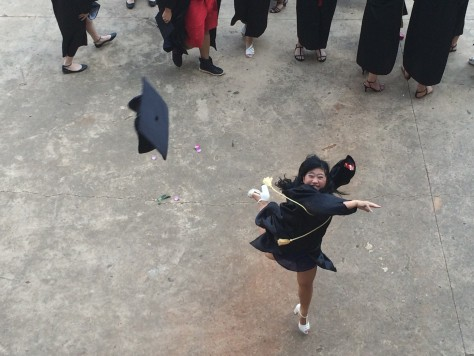 In celebration, all the students threw their caps into the sky.
