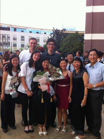 Taking photos with families of graduates