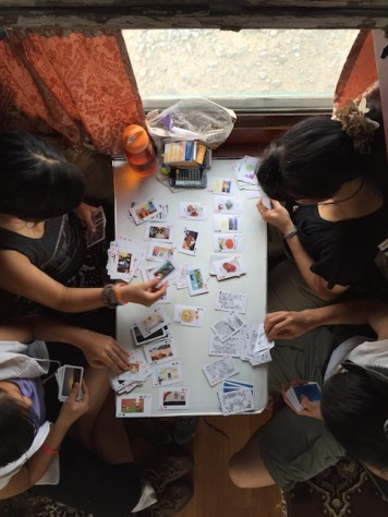 "The children took break from their home schooling work by playing a card game call ""Nerds""."