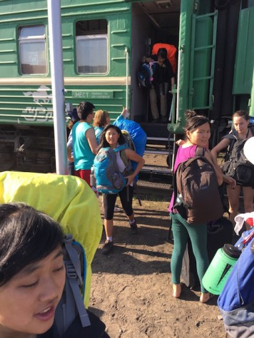 Getting off the train after sleeping overnight on the Mongolian train.