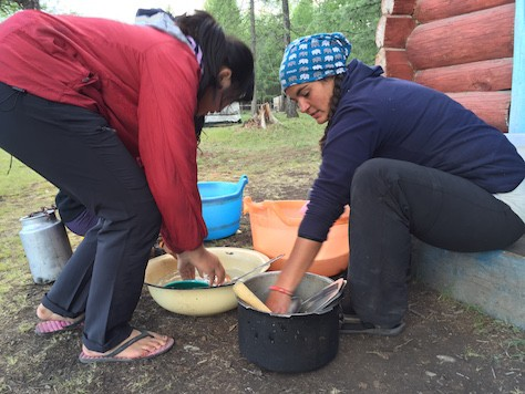 Joani learned how to wash dishes in the ger camp from Nelly (right) using as little water as possible.