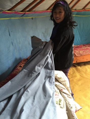 After guests left, Olivia helped to change and wash the beddings in the gers.
