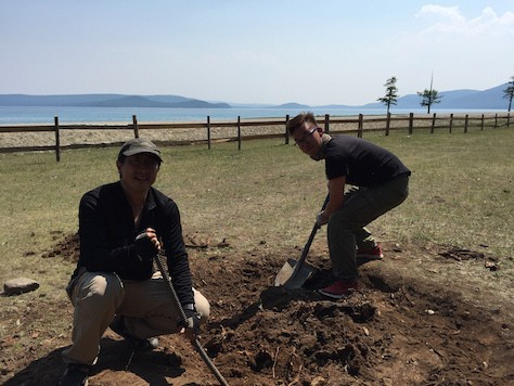 Andrew, a HK guest at the ger camp, volunteered to help with digging up the roots of the tree for making a campfire pit.