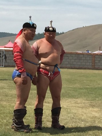 Mongolian wrestlers wears tight fitting brief and chest exposing bolero over their stout bodies and beer bellies.