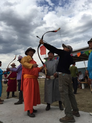 After the archery competition, the archers taught Nathan how to shoot like Mongolians.
