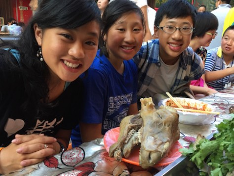 At the Lanzhou night market, the children tried eating a whole sheep head for the first time. It was DELICIOUS!