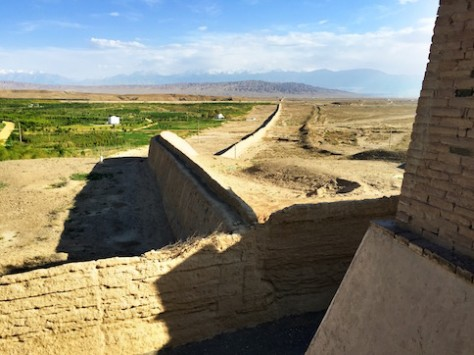 The gate and the great wall form an ancient formidable barrier blocking the narrow 15km opening between two great mountain ranges.
