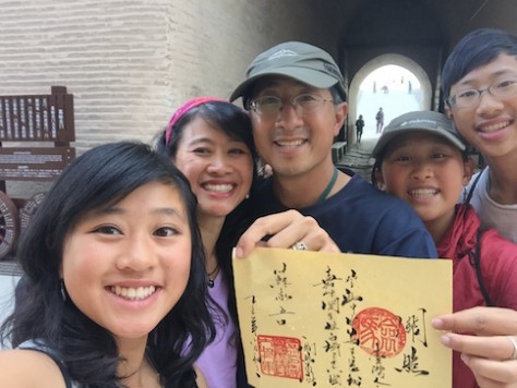 "We received the ""Su Family(苏家五口)"" official passport stamp to leave China proper at the Jiayuguan Gate!"