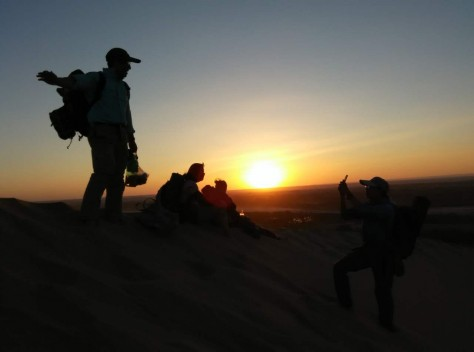 Seeing the sun setting over the horizon on top of the sand dune was one of our most memorable experience.