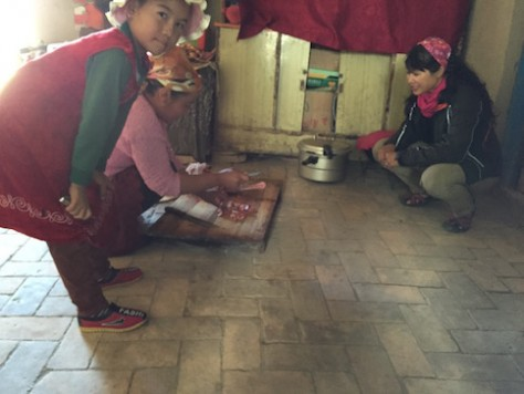 Annie observed and learned how the village woman prepared the local dish.