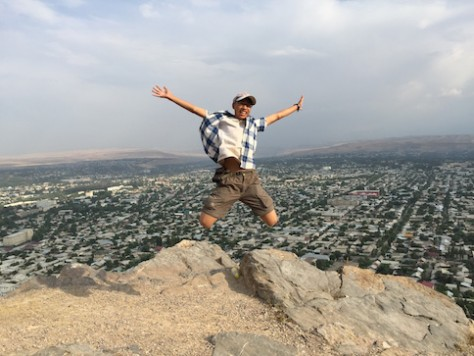 Jumping on top of the Solomon Mountain overlooking the city of Osh.