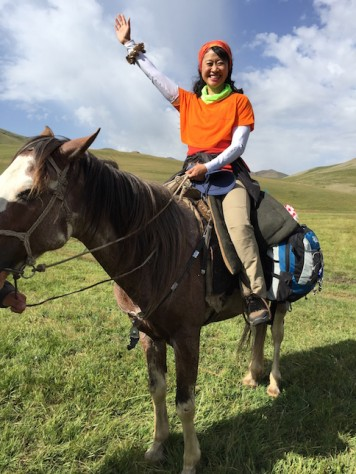 Annie enjoyed riding high above the ground on her majestic grey spotted lead horse for her birthday surprise from fellow trekkers.