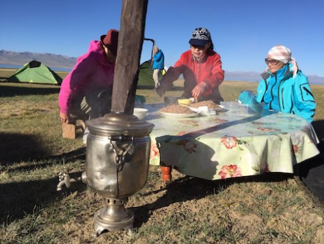 "Madina, her mother, and mother's friend enjoyed having a special Russian ""hot pot"" for boiling water for tea time in the morning."