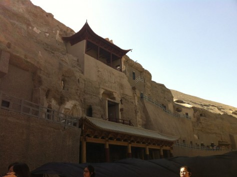 Mogao Caves consists of hundreds of caves with painted buddhist murals and statues.