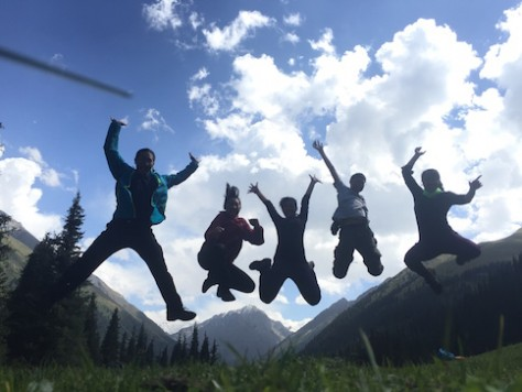 Jumping for joy at the alpine valley of Atlyn Arashan.