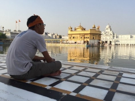 The golden temple is situated in the middle of a large pool surrounded by four sides of large marble walkways.