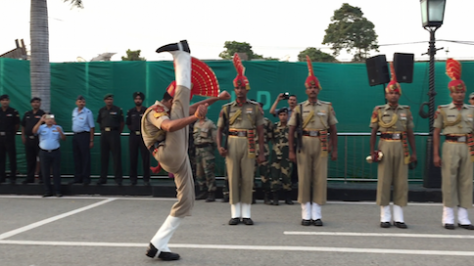 As a show of national pride, border guards from India and Pakistan compete to see who can kick the highest.