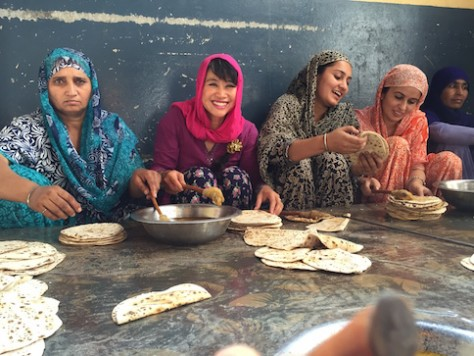 Annie worked with other women to butter the chapatti bread.