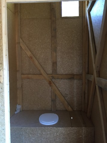The toilet is made to enable composing of the feces as fertilizer for future tree planting. It does not smell at all!