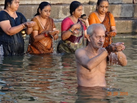 Pilgrims bathe themselves before worshipping at the Golden Temple of Shiva.