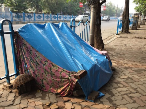 The people living in the street built simple shelters at night.