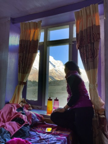 From our beds, we have a panaromic view of the Annapurna mountains through our hostel window.