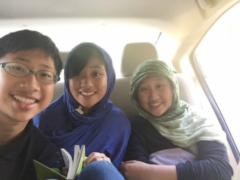 The three children sat in the back of the car where they could do homework, play cards, sleep, and have fun!