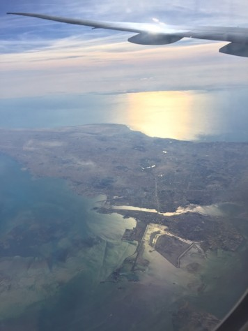 We flew over the country island of Bahrain on Qatar Airline.