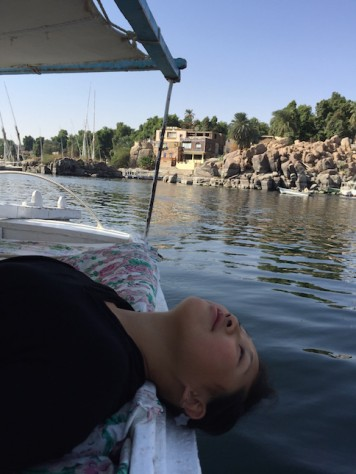 Joani relaxed on the desk of the felucca sailboat.