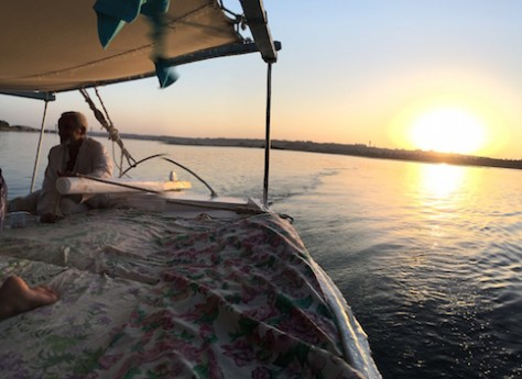 The sun glowed in orange as it set on Nile river.