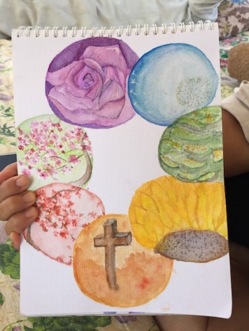 Annie drew 7 circular paintings for Olivia representing the 7 colors of the rainbow.