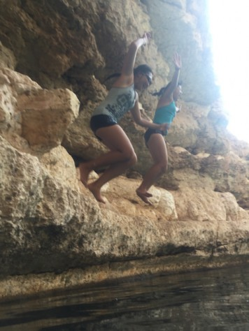 We kept taking turn jumping off the cliff of the sink hole.