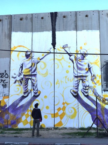 Nathan walked along the wall at Bethlehem, which is covered by very artistic graffitis.