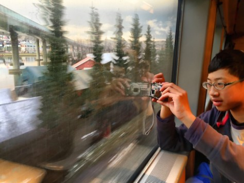When we saw the sceneries outside the train in Norway, we wanted to capture them badly because the sunset over the snowy landscape was heavenly.