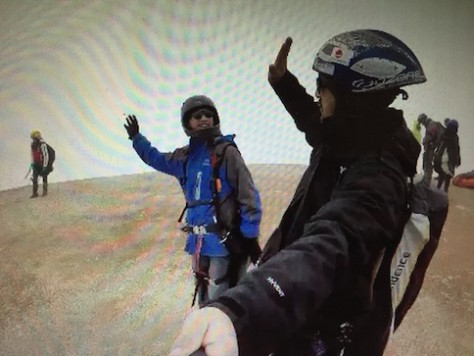 A high five before Nathan jumped off for paragliding.