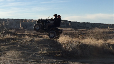 Nathan, the crazy teenager, flew into the sky on a quad bike with Olivia screaming behind him.