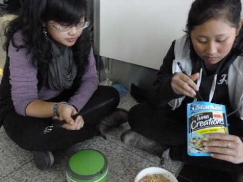 We cooked instant noodles using our portable stove as we waited for 10 hours at the airport.