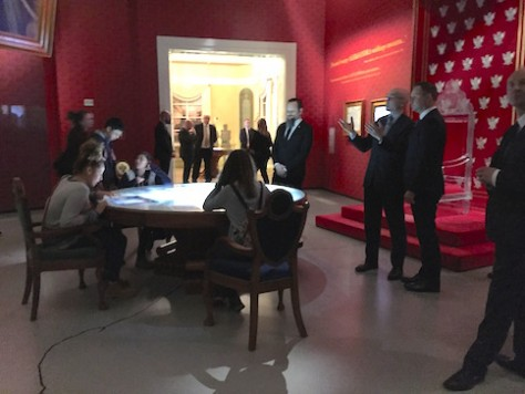 The children were sitting in front of the president of Poland who was visiting the Polish Jews Museum.