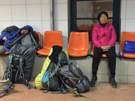 Grandma tried to sleep in the train station as we waited for the connecting train late at night.