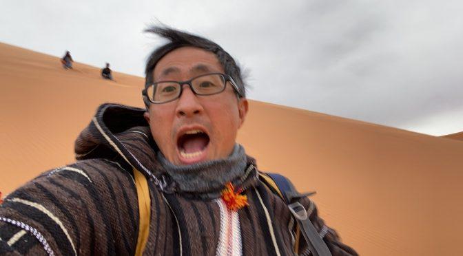 Running down 50-story Sahara sand dune